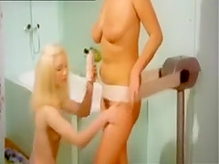 Girls enjoy vintage massager machine