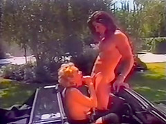 Horny blonde fucked in a convertable