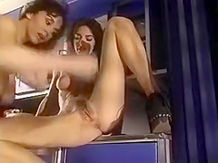 Two lesbo brunettes eat and finger pussy