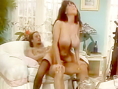 Big titted brunette in anal action