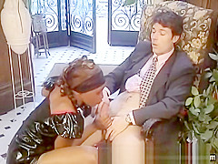 Beautiful African maid in latex sucks off her white master