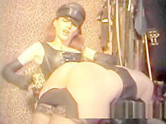 Luscious redhead tart enjoys being spanked hard in the dungeon