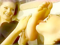 Maid worships lesbian feet