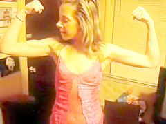 Bridget flexing her biceps
