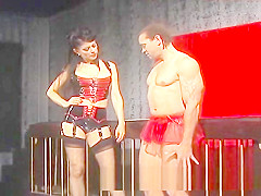 Mistress Natasha Sweet has fun with her helpless caged slave
