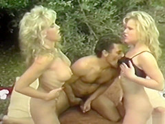 Two blondes lesbian following by threesome in the garden VHS Lovers
