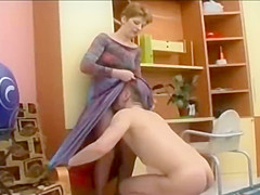 Hot ameatur CFNM femdom woman recieves cunnilingus sitting in a dress