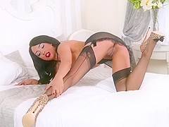 Hot ebony babe Kayla Louise wanks off in nylons girdle heels