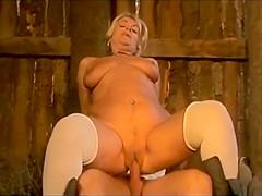 Busty MILF enjoys big cock in her ass
