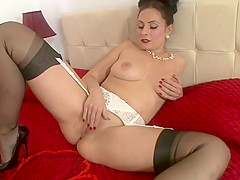 Big-boobed Vintage Flash brunette looks awesome in black stockings