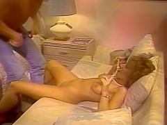 Retro Blonde Sucks A Cock On A Striped Bed