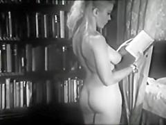 Margaret Nolan.  The four poster